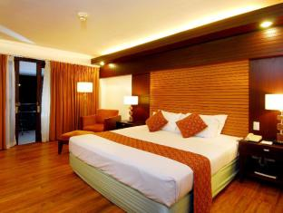 Waterfront Airport Hotel and Casino Cebu-Stadt - Gästezimmer