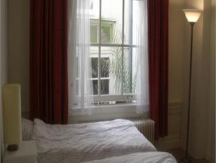 Canal Rooms Amsterdam Apartment امستردام - غرفة الضيوف