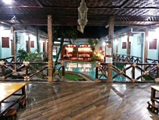 Moana Hotel Inn and Diving Center Puerto Princesa City - Night View of Restaurant from the Reception Area