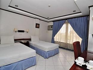 Soledad Suites Bohol - Habitació