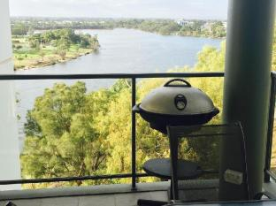 Swan Riverside Luxury Apartment Perth - bbq and dining table on balcony