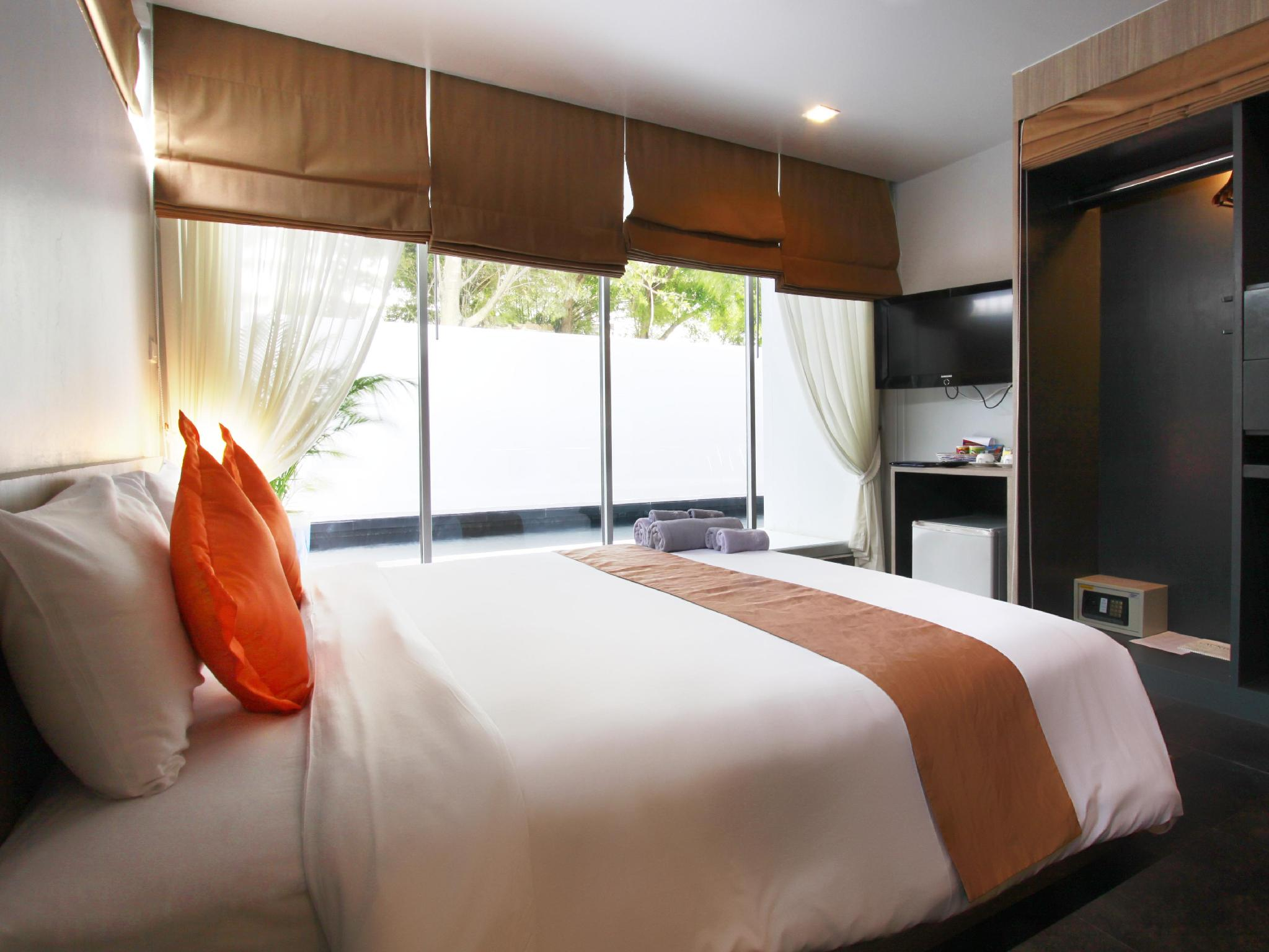 The Belle Resort Phuket - Hotellihuone