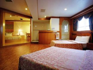Nan Pao Hotel Tainan - Gæsteværelse