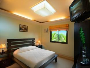Bohol Casa Nino Beach Resort בוהול - חדר שינה