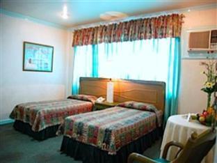 Villa Margarita Hotel דבאו - חדר שינה