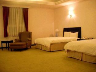Her Kang Hotel - Room type photo