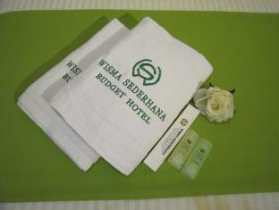 Wisma Sederhana Budget Hotel מדאן - חדר אמבטיה