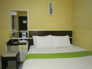Wisma Sederhana Budget Hotel מדאן - חדר שינה
