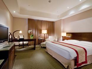 Queena Plaza Hotel - Room type photo