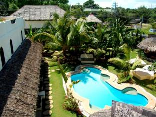 Charts Resort & Art Cafe Panglao Island - Swimming Pool and Garden View