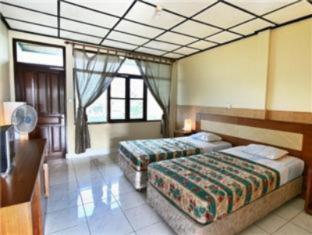 Villa Puri Royan באלי - חדר שינה