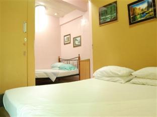 Ellen's Apartelle - Room type photo