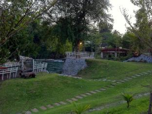 Watermill Resort Khao Yai - BBQ and sitting area by the creek