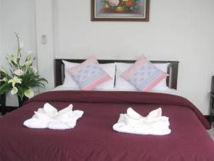 Oceans 7 Beach Guesthouse Pattaya - Gästrum