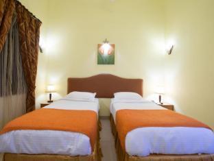 Cochichos Resort Goa Utara - Kamar Tidur