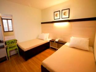 Sugbutel Family Hotel Cebu City - Gästrum
