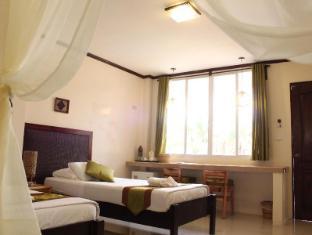 Palms Cove Resort בוהול - חדר שינה