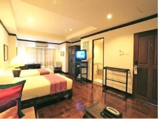 Cucumber Inn Suites and Restaurant Pattaya - Deluxe Twin Suite Room
