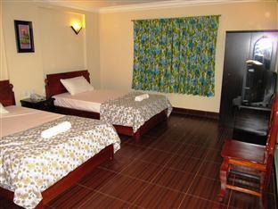 Sun City Guesthouse Phnom Penh - Deluxe Twin Bedroom