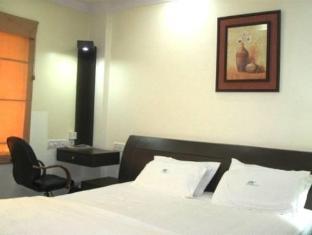 Compact Lotus Suites Bangalore - Habitación