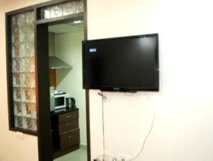 Compact Lotus Suites Bangalore - Interior del hotel