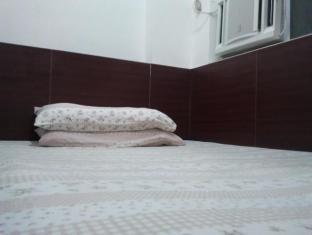Guangzhou Guest House Hong Kong - Gästrum