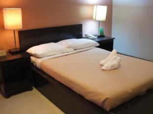 North Palm Hotel and Garden דבאו - חדר שינה