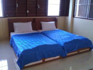 Ruan Rom Mai Bungalow פוקט - חדר שינה