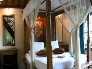 Gunung Merta Bungalows באלי - חדר שינה