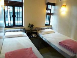 New International Guest House Hong Kong - Hotellihuone