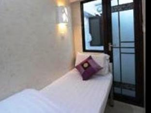 New International Guest House Hong Kong - Habitació
