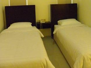 Panggon Guesthouse سورابايا - غرفة الضيوف