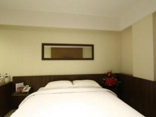 Cititel Hotel Pekanbaru Pekanbaru - Kamar Tidur