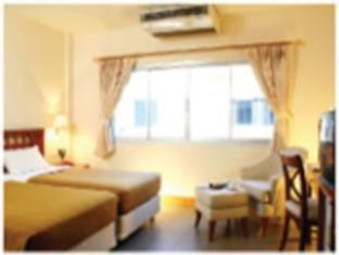 Karon Beach Inn Phuket - Cameră de oaspeţi