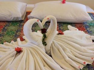 Guesthouse@Karon بوكيت - غرفة الضيوف