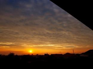 H.O.M.E Guest House Surabaya - Sunset view from our rooftop terrace