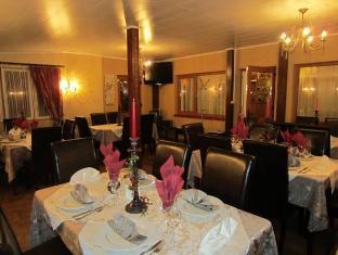 Dominika Guesthouse تالين - المطعم