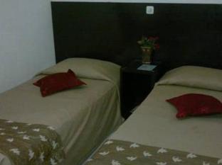 Cherry Red Hotel מדאן - חדר שינה