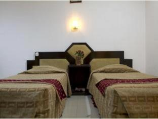 Cherry Red Hotel Medan - Guest Room