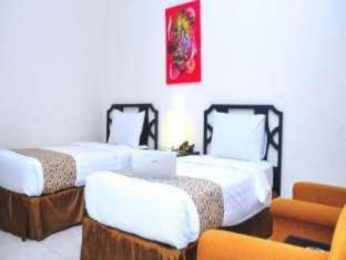 Grand Surabaya Hotel סורבאיה - חדר שינה
