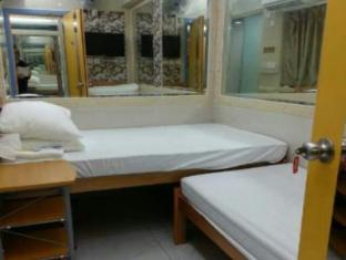 Tsim Sha Tsui Hotel Hong Kong - Pokoj pro hosty