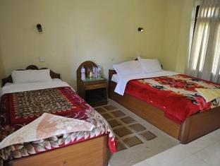 Travellers Jungle Camp Công viên Chitwan - Phòng khách