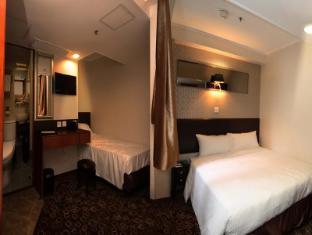 Lander Hotel Prince Edward Hongkong - Külalistetuba