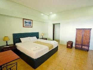 Danao Coco Palms Resort סבו - חדר שינה