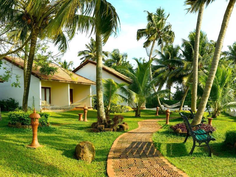 Abad Whispering Palms Kumarakom Hotel - Hotell och Boende i Indien i Kumarakom
