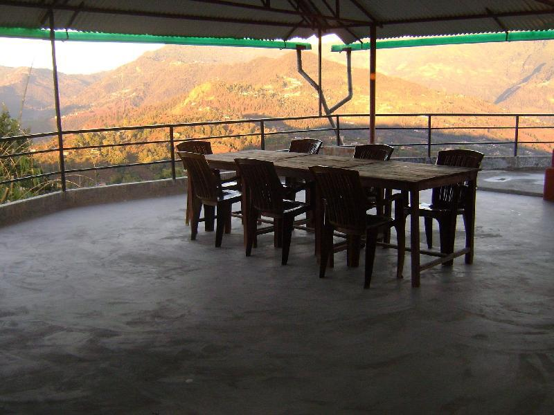 Roof top Restaurant with view of morning sun falling in Dhital and Dhampus