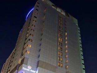 Sands Hotel Abu Dhabi Abu Dhabi - Hotel exterior by night