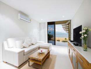 b1 beachfront apartment