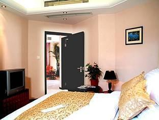 Shanghai Howard Johnson All Suites Hotel Shanghai - Bedroom