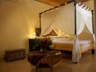 Rambutan Lovina Hotel Bali - Külalistetuba